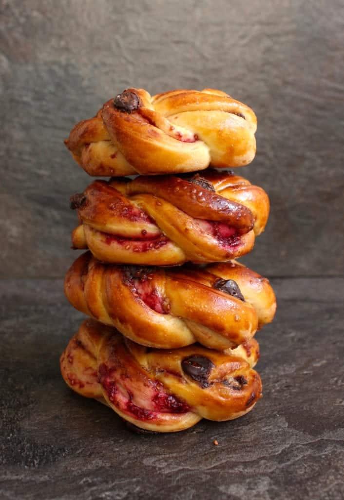 Stack of raspberry chocolate brioche buns.
