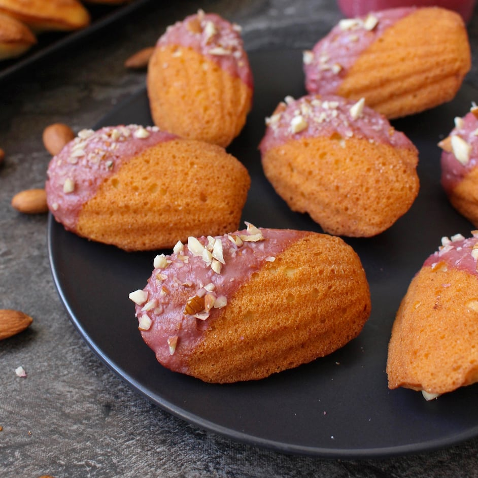 Madeleines placed over a black plate
