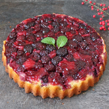 Blackberry Upside Down Cake on a grey surface