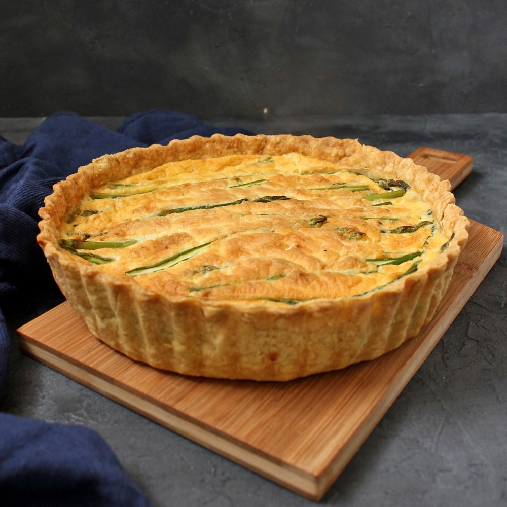 Feta and Asparagus Quiche on a wooden board