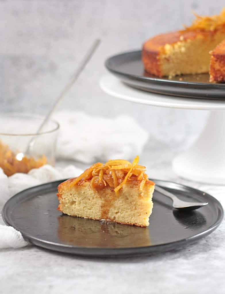 Slice of Orange Almond Cake with Orange Syrup and Candied Oranges
