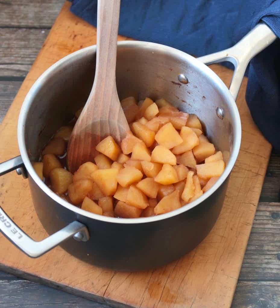 Cut apples in a metal pot
