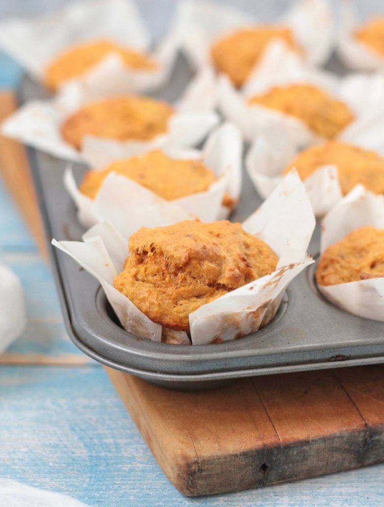 close up on a carrot muffin in the pan.
