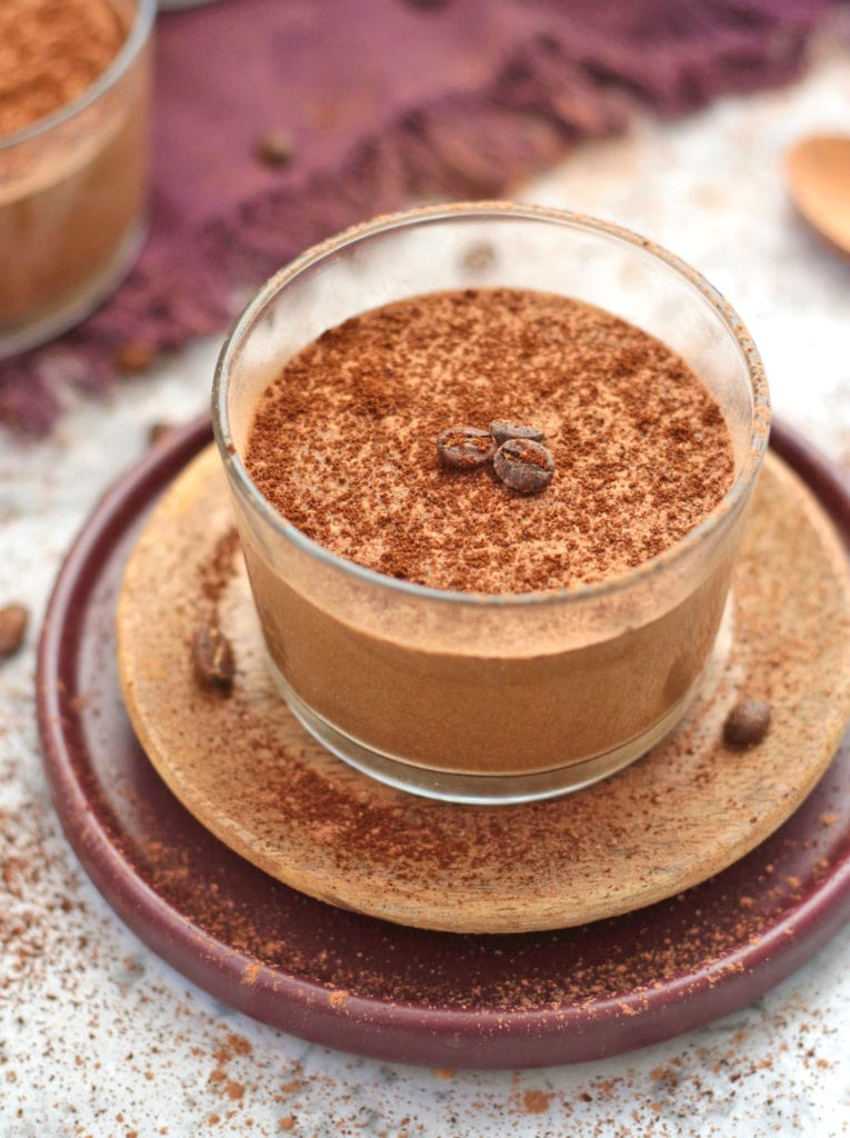 Coffee Mousse on a cup with Coffee Beans