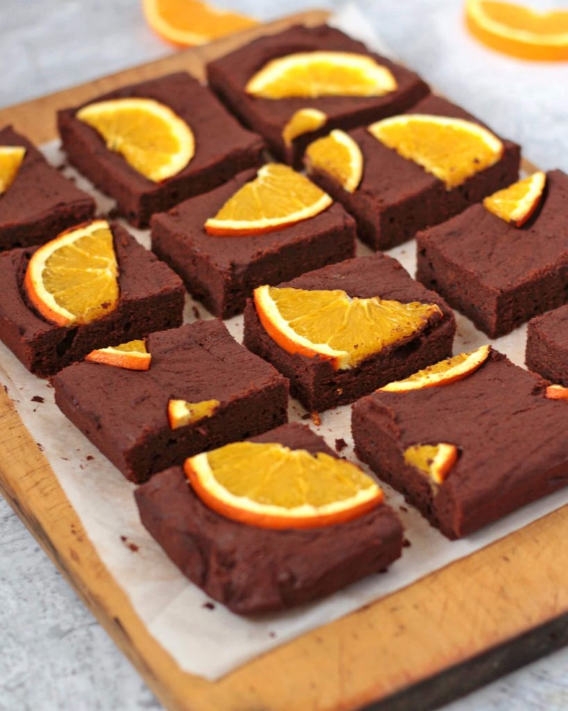 Brownies with fresh oranges sliced in individual pieces