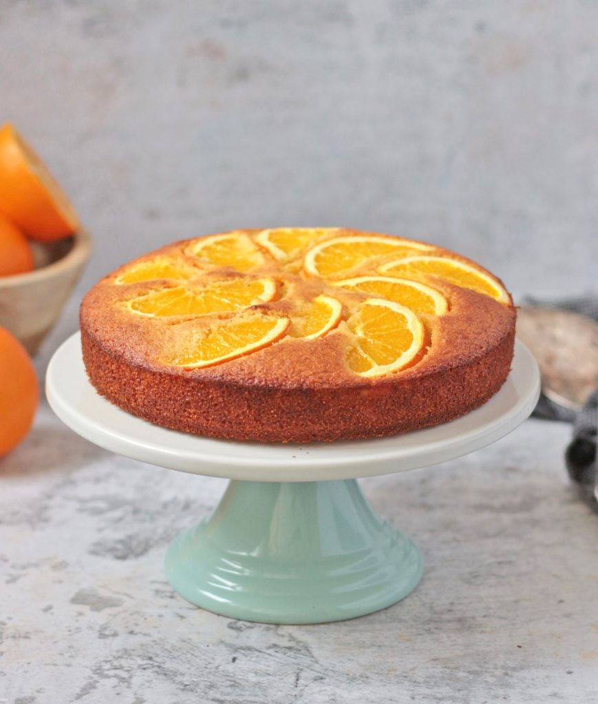 Orange Semolina Cake on a cake stand