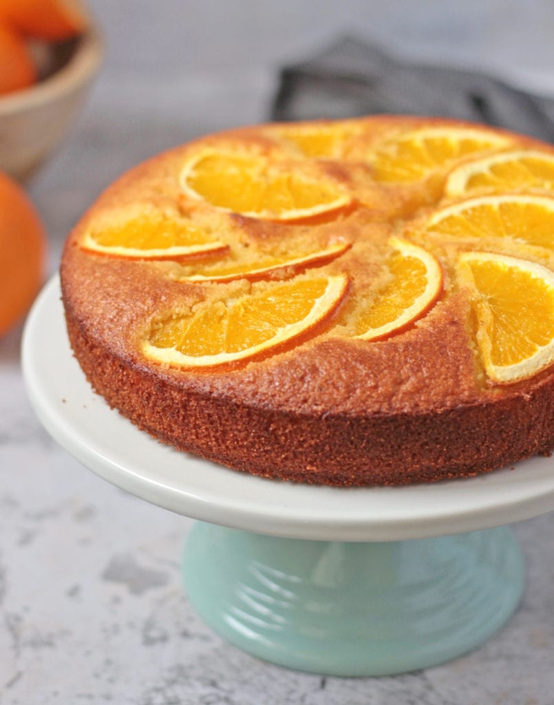 Close up on the fresh orange slices over the cake