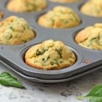 Close up on a Cheddar and Spinach Muffin in the muffin pan