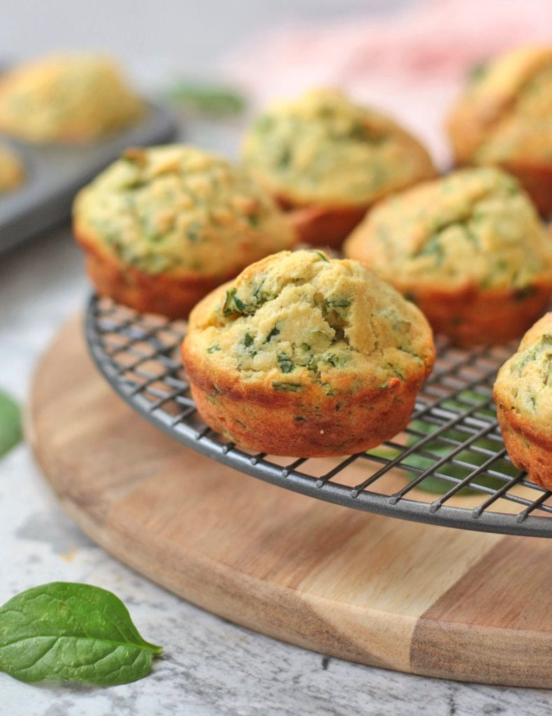 Cheddar Spinach Muffins on a cooling rack