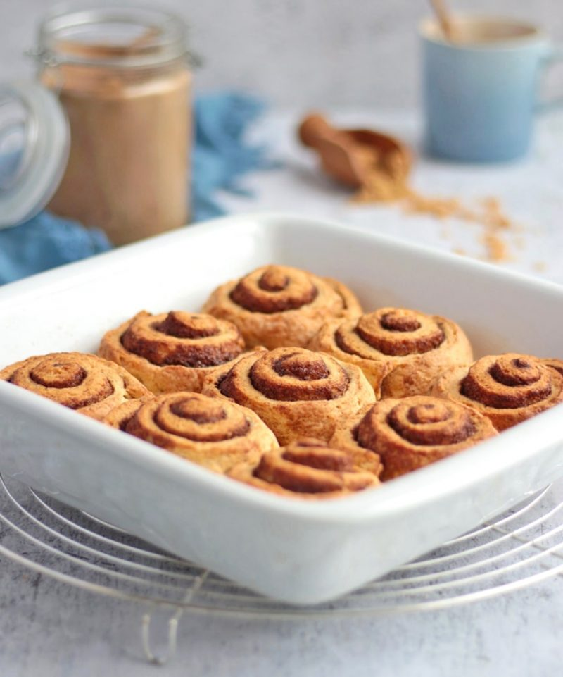 Baked rolls in a white ceramic dish on a round cooling rack
