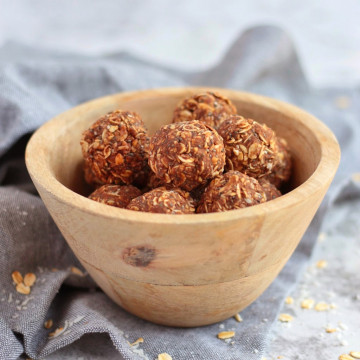 Peanut Butter Energy Balls in a wooden bowl