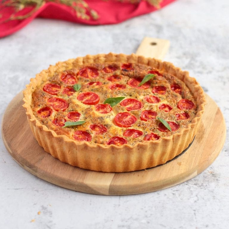 Cheese Quiche with Tomato on a serving board