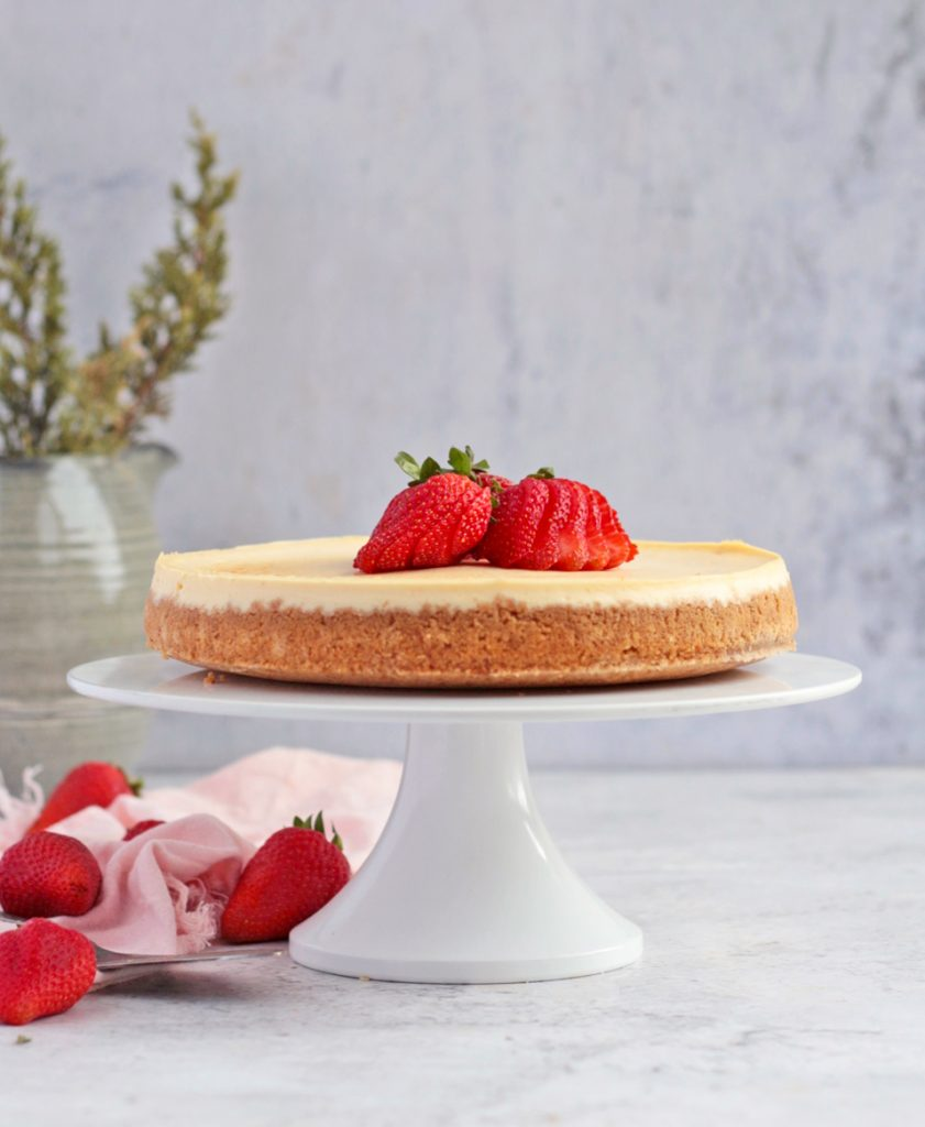 Lemon Ricotta Cheesecake on a white Cake Stand