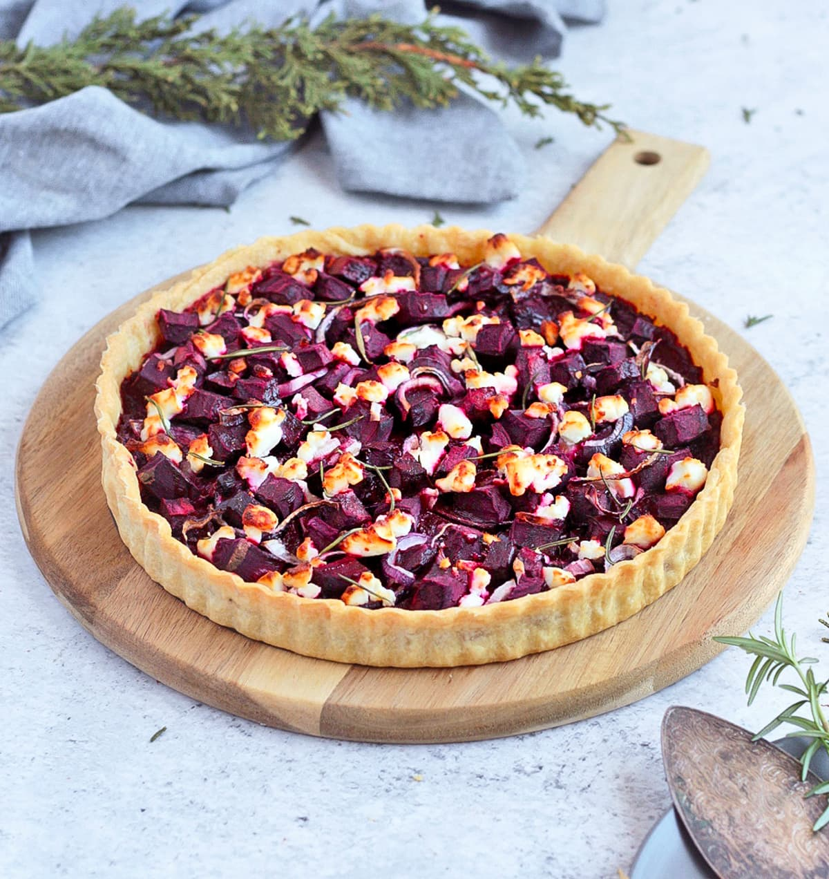 Baked Savoury Tart on a wooden serving board