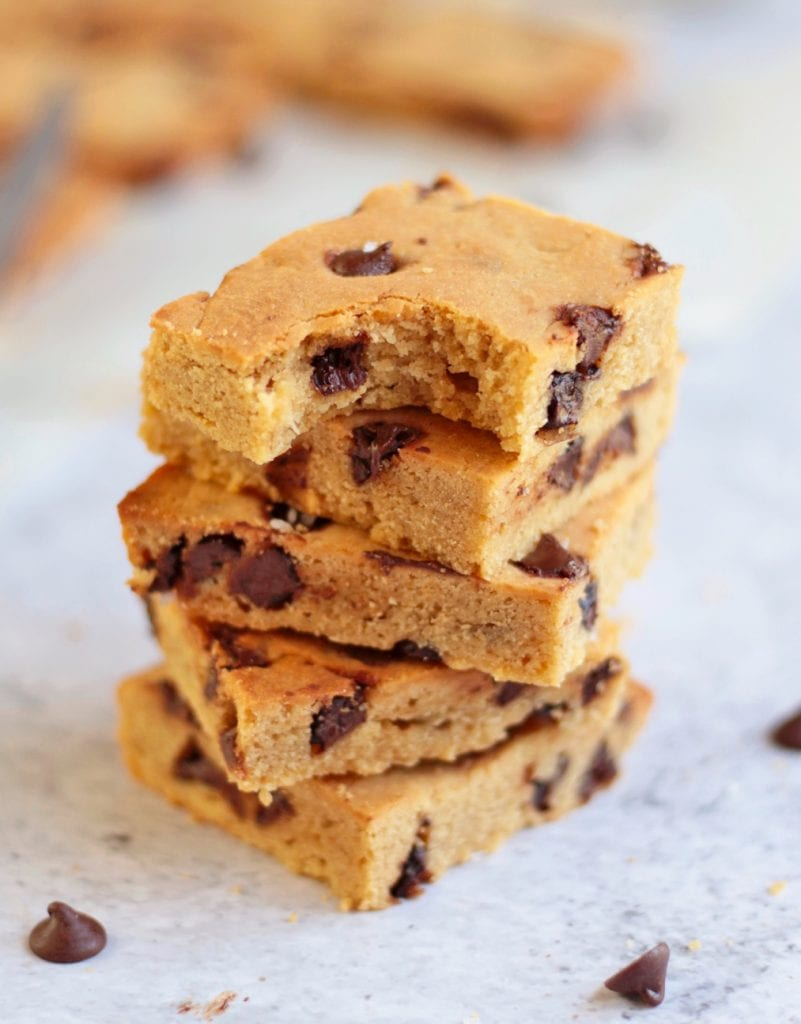 Stack of the chocolate chip bars with a bite off