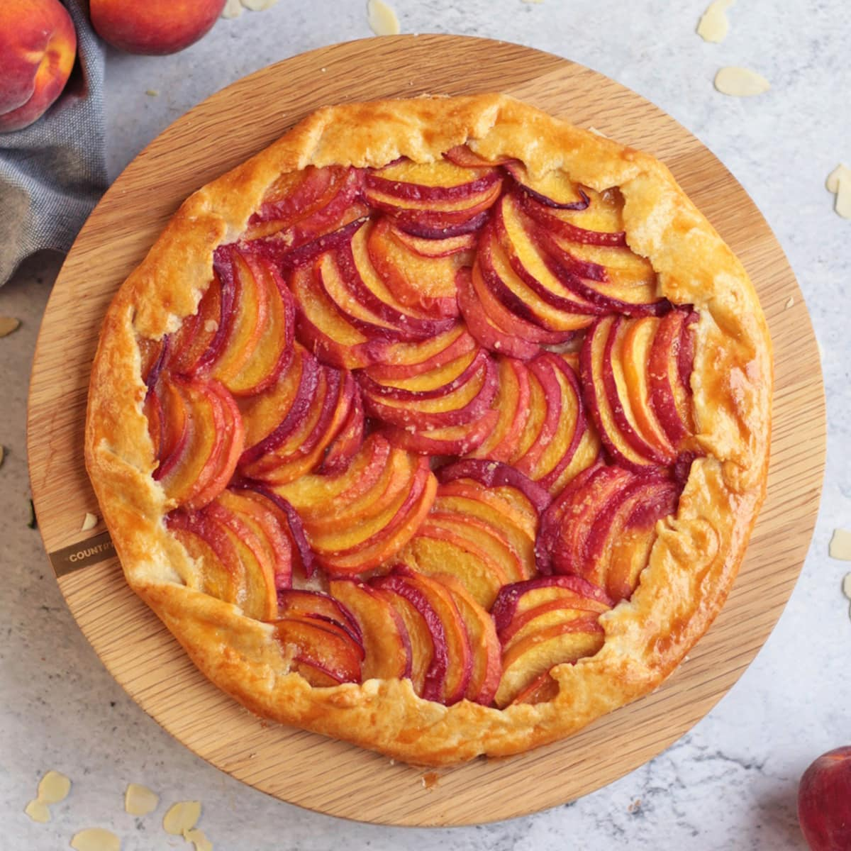 Almond Peach Galette from above on a wooden stand
