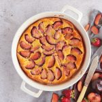 Plum Clafoutis from above in a white ceramic dish