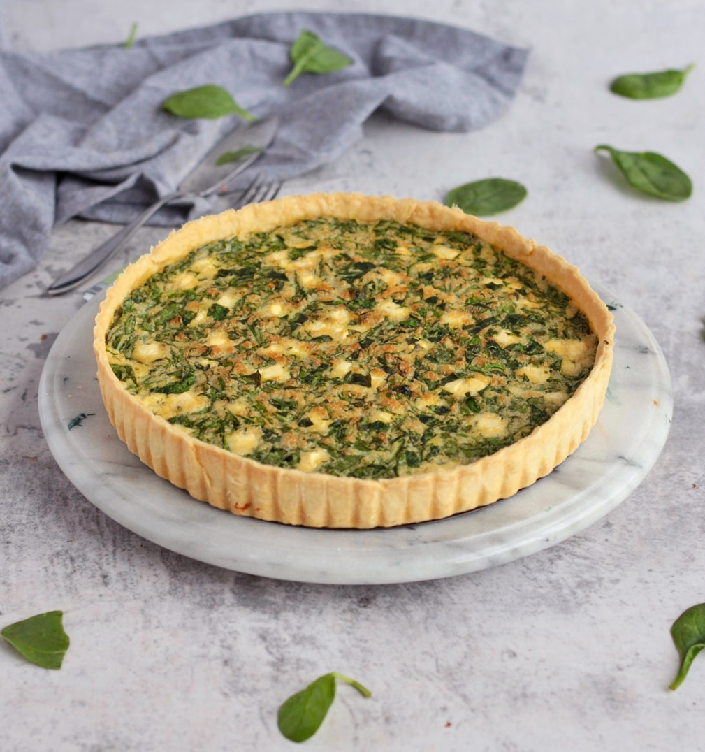 Feta Quiche on a Marbled Board.