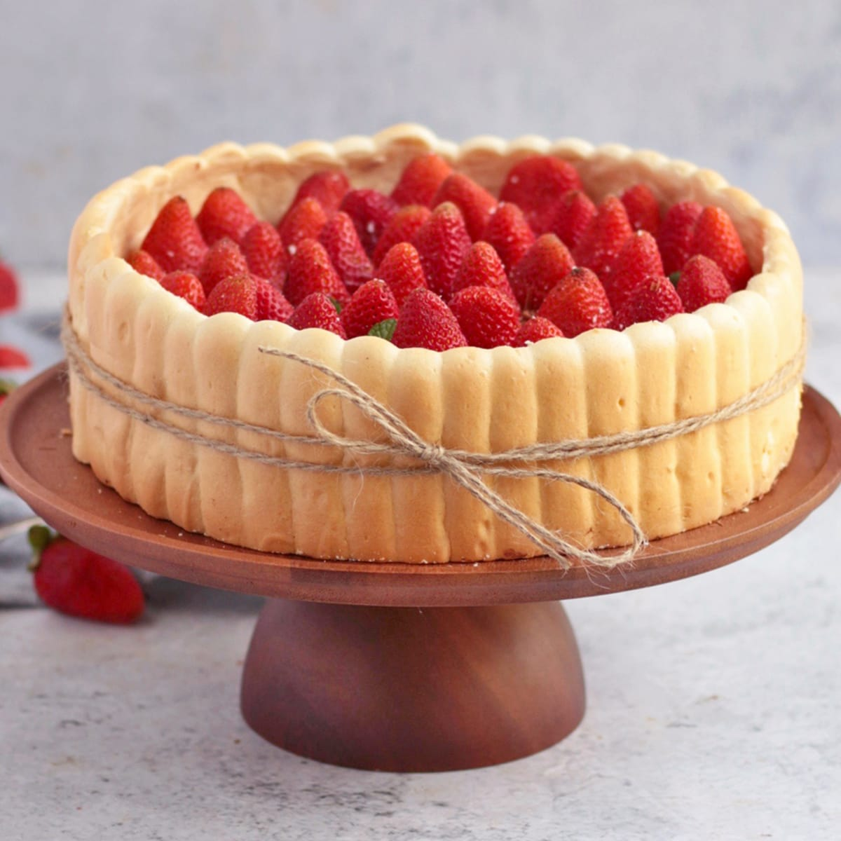 Strawberry Charlotte Cake on a wooden Cake stand