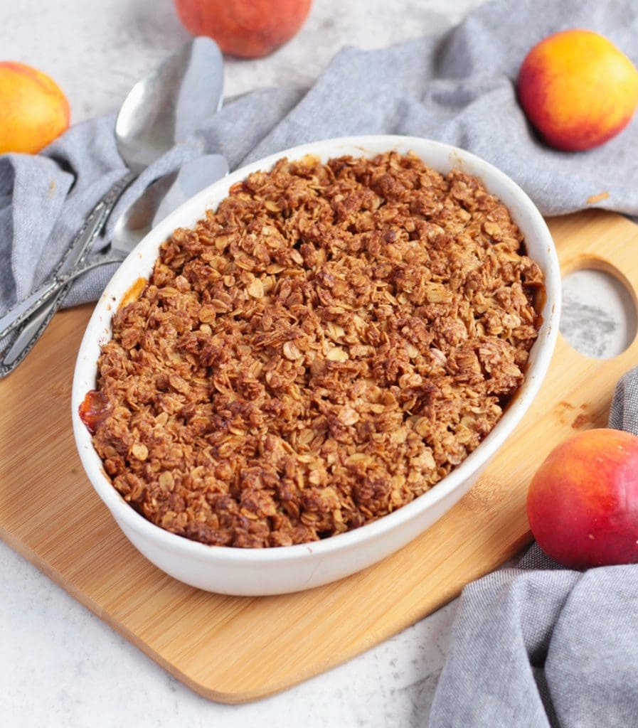 Baked apricot crumble over a wooden board