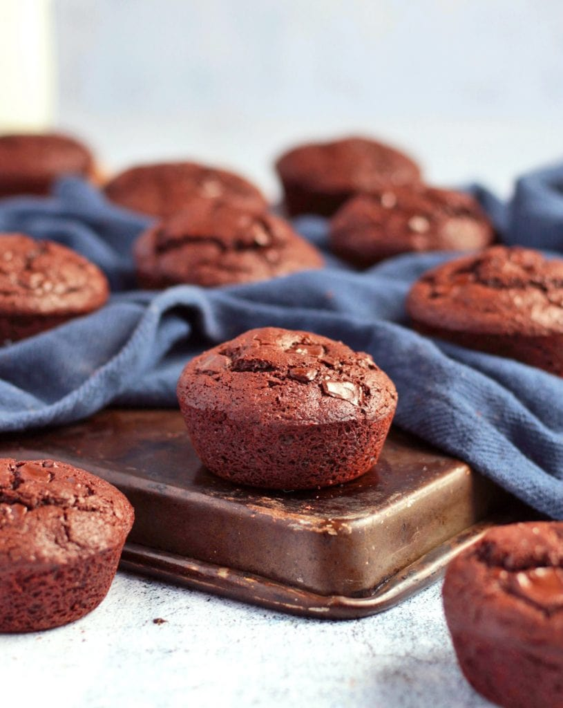 Muffins on a baking tray with blue napkin