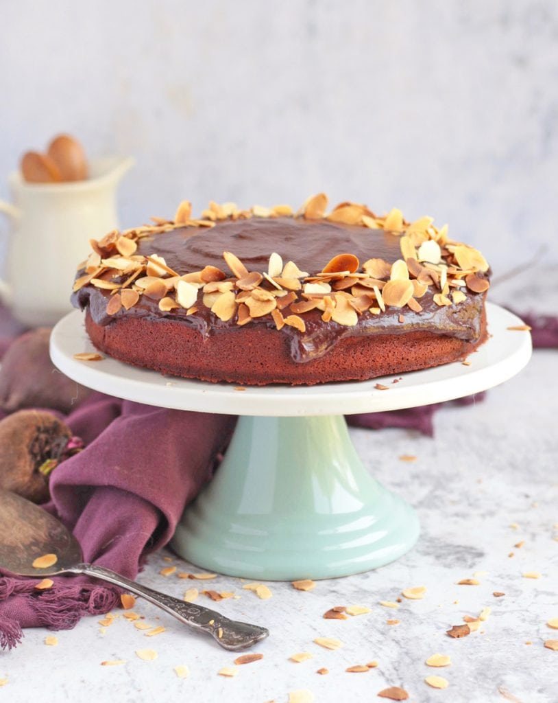 Chocolate Cake on a Cake Stand with chocolate ganache and toasted almond flakes