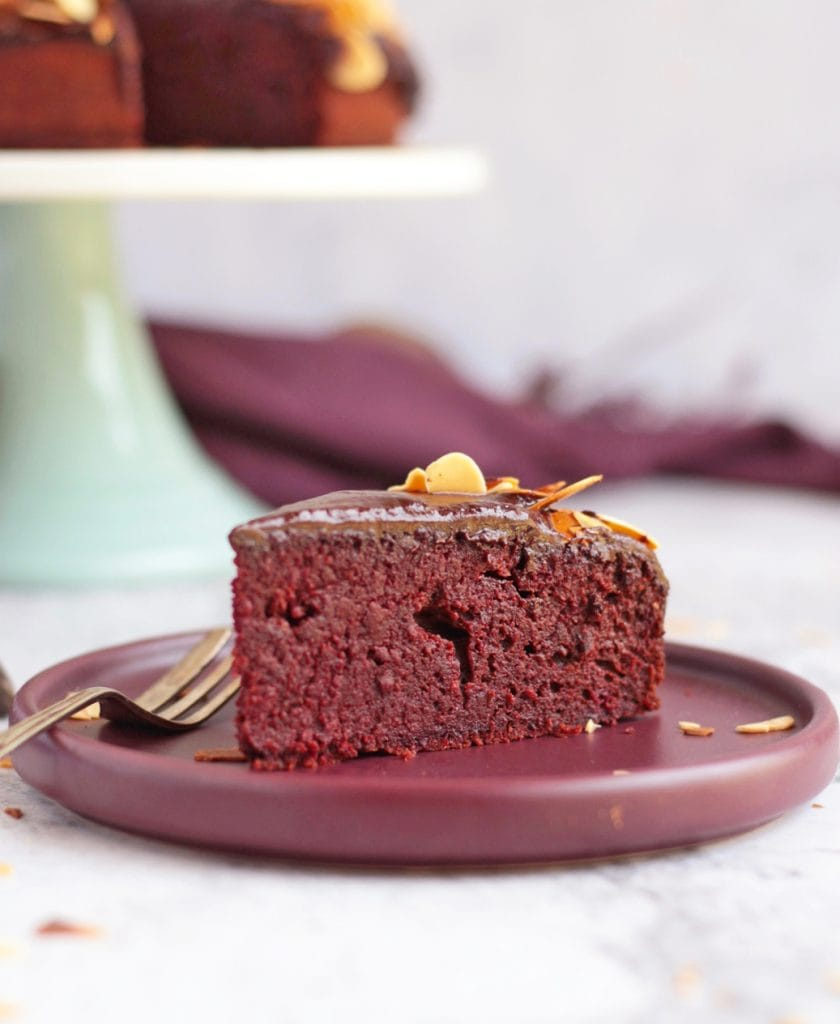 A slice of chocolate and beetroot cake on a purple plate