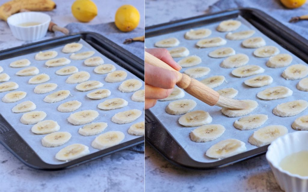 Placing the banana slices on a tray and brushing them with lemon juice