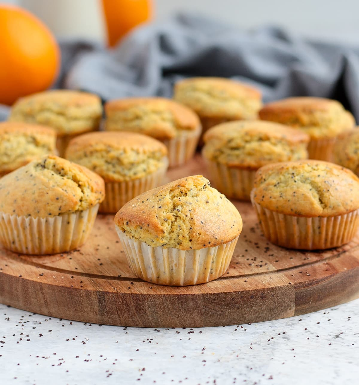 Baked muffins placed over a round wooden board.