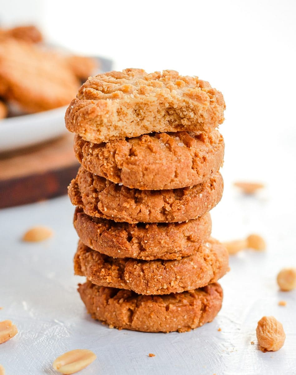 Stack of cookies with a bite taken off the top cookie