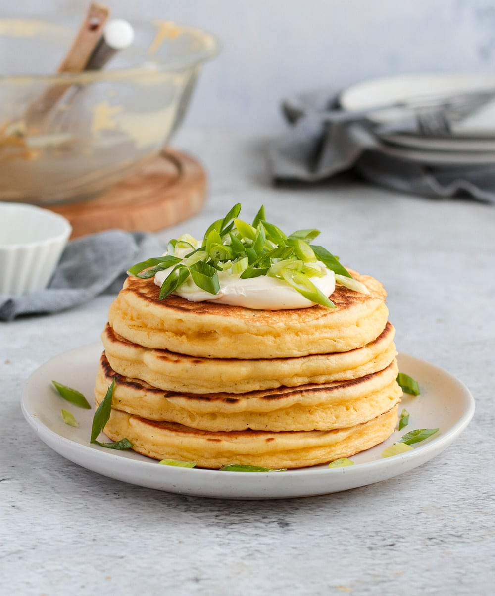 Stack of 4 pancakes on a white plate.