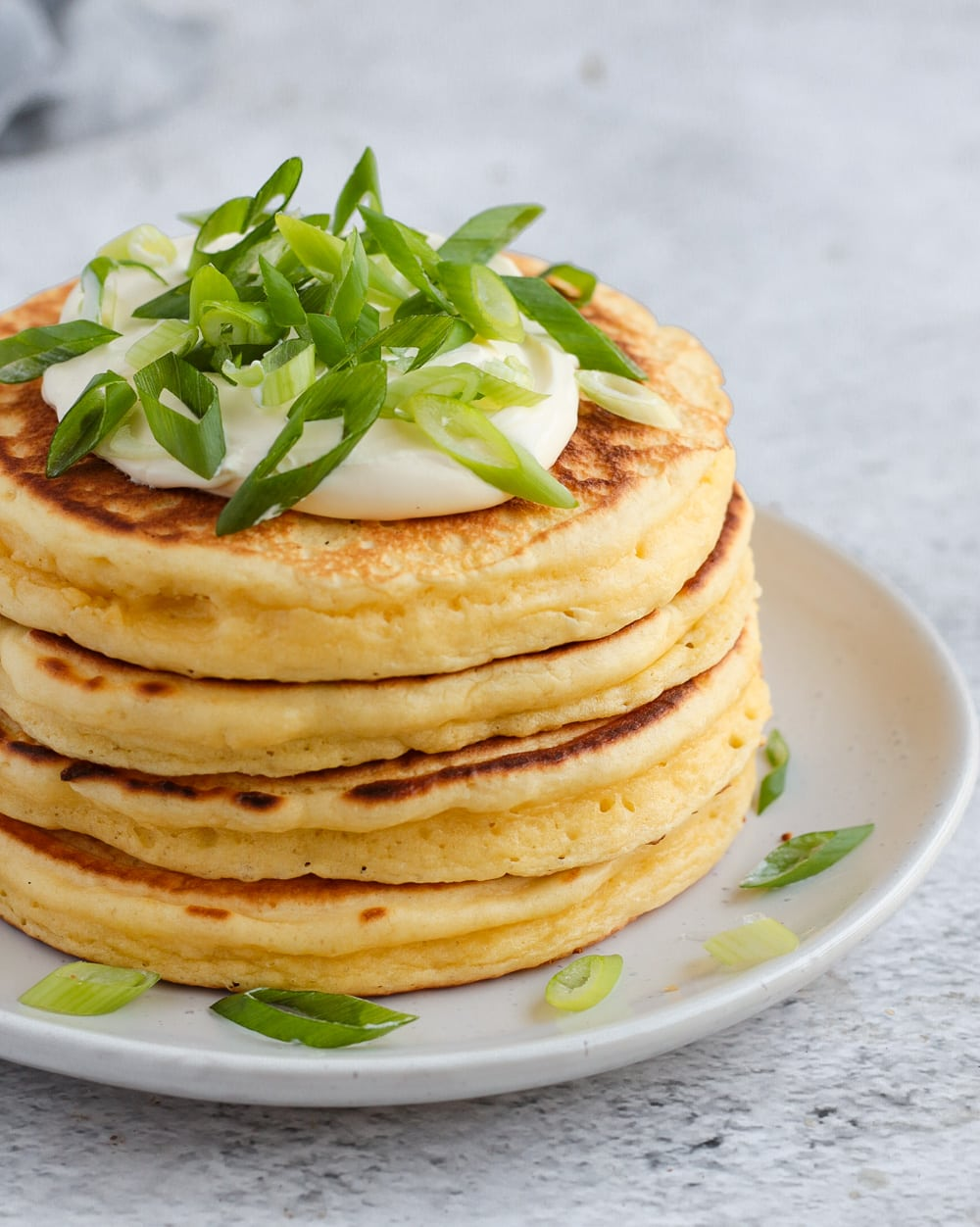 Pancake Stack topped with Sour Cream and Spring Onions.