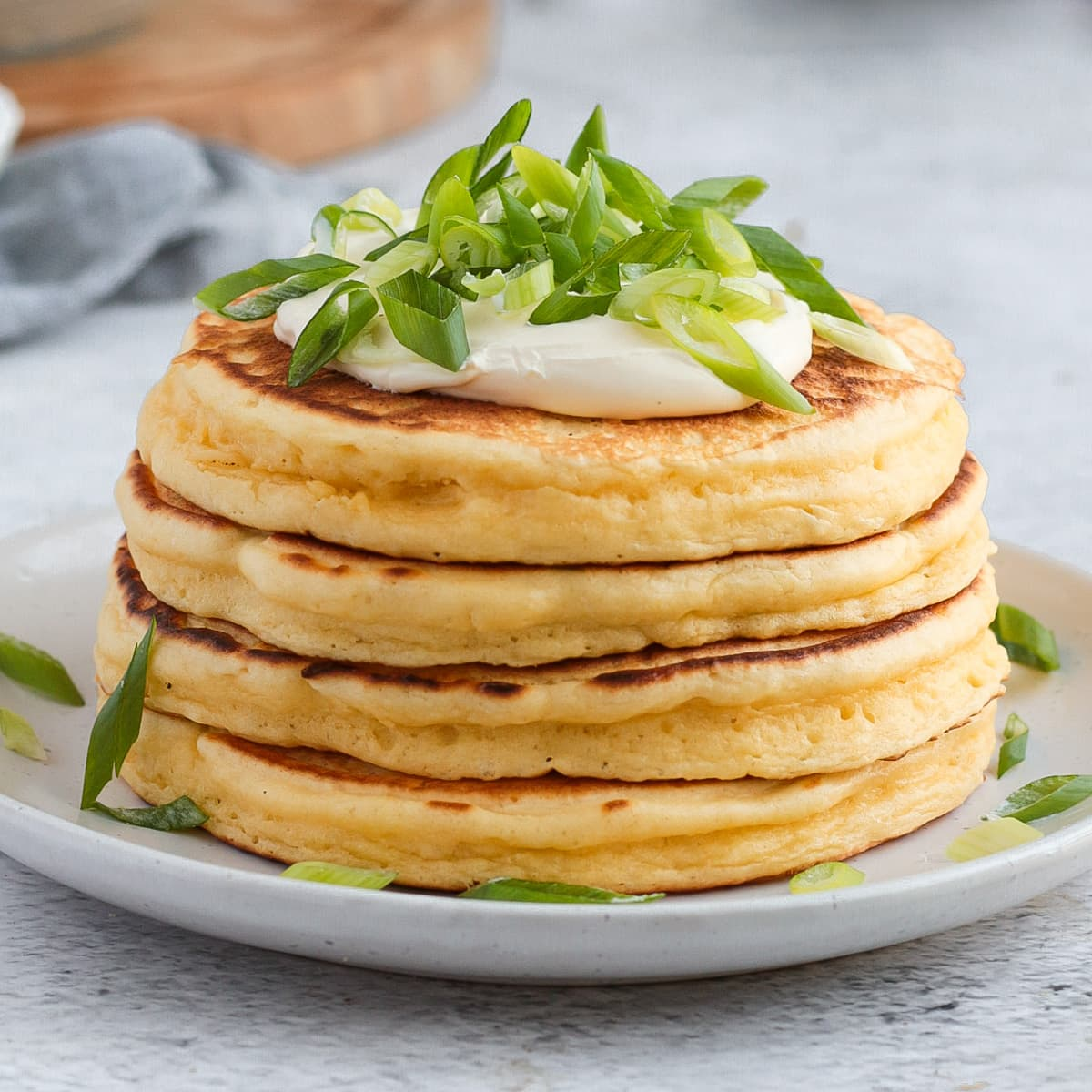 Close up on a stack of 4 pancakes on a white plate