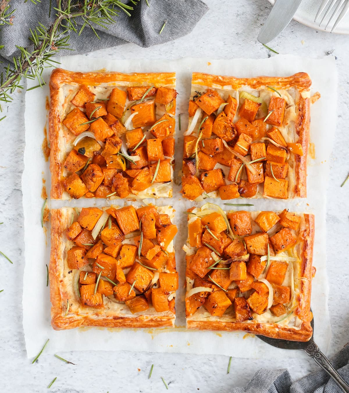Flatlay of the pumpkin tart sliced in 4