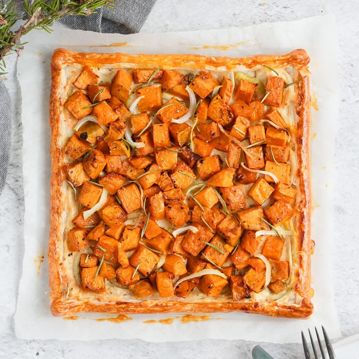 Pumpkin tart from above over a sheet of baking paper
