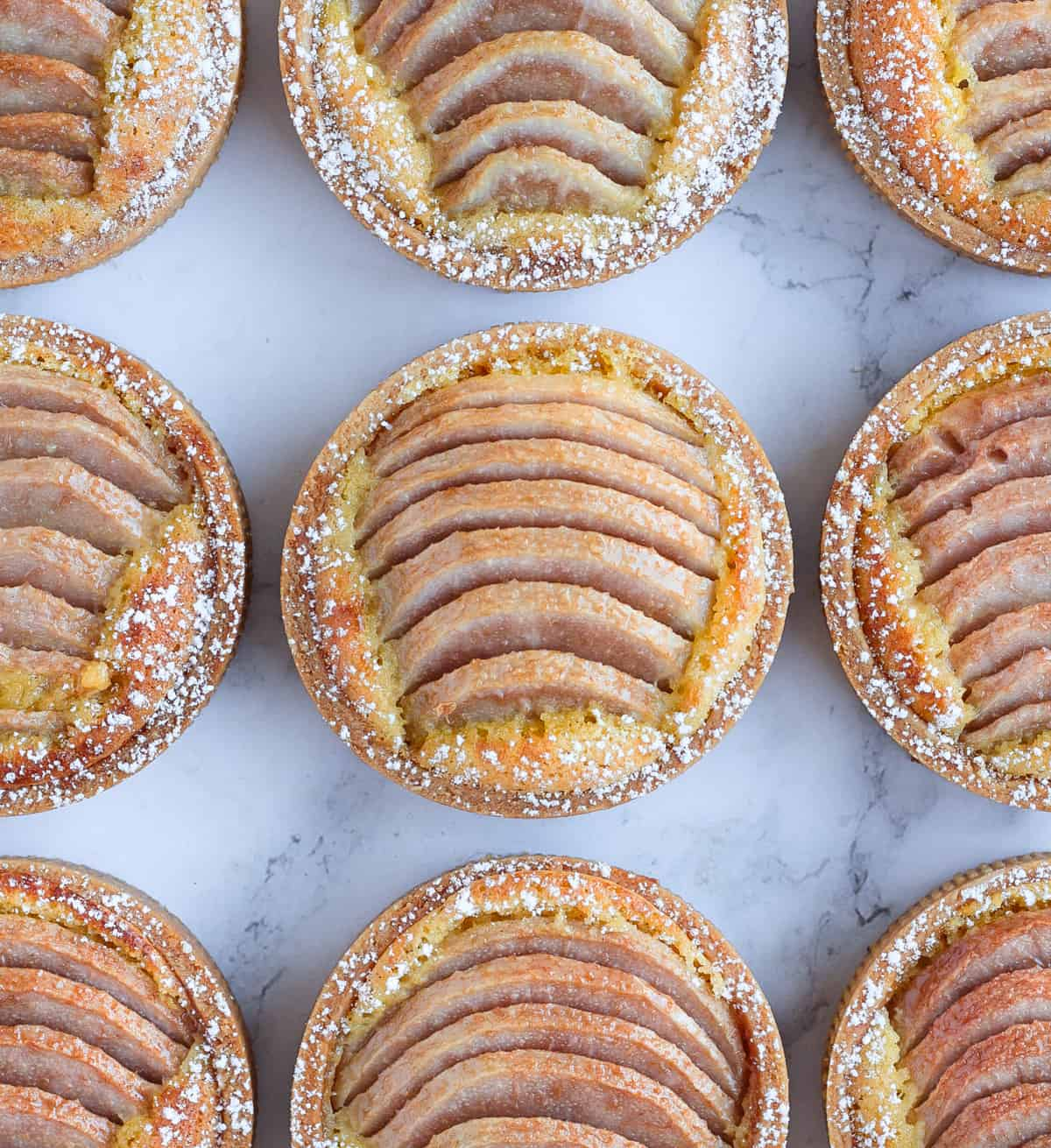 Pear Tartlets aligned in a grid photographed from above.