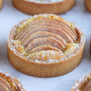 Close up on one tartlet on a grey surface.