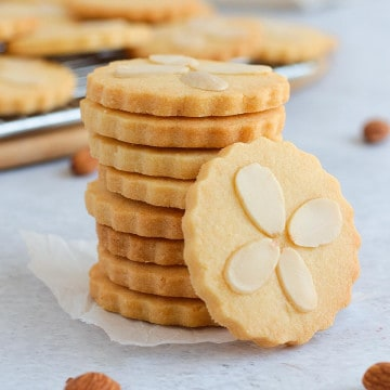 Stack of Cookies decorated with Flaked Almonds.