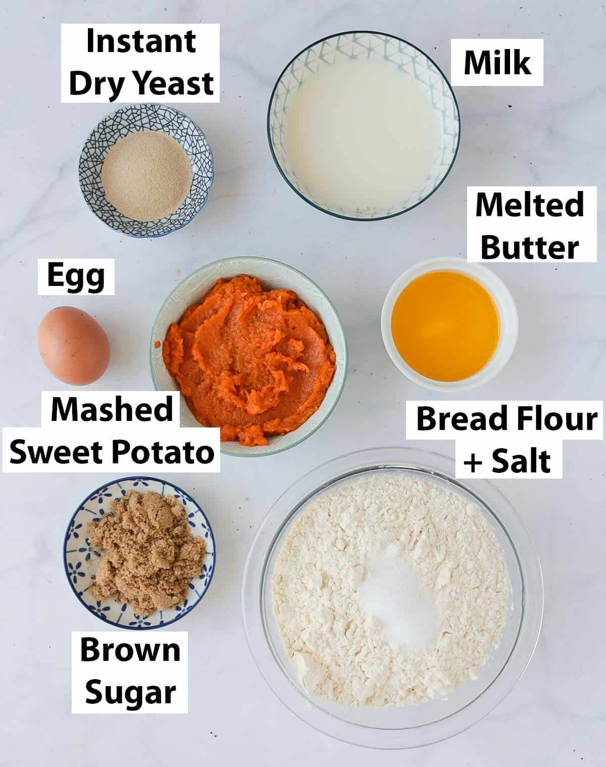 Ingredients over a white marble surface.