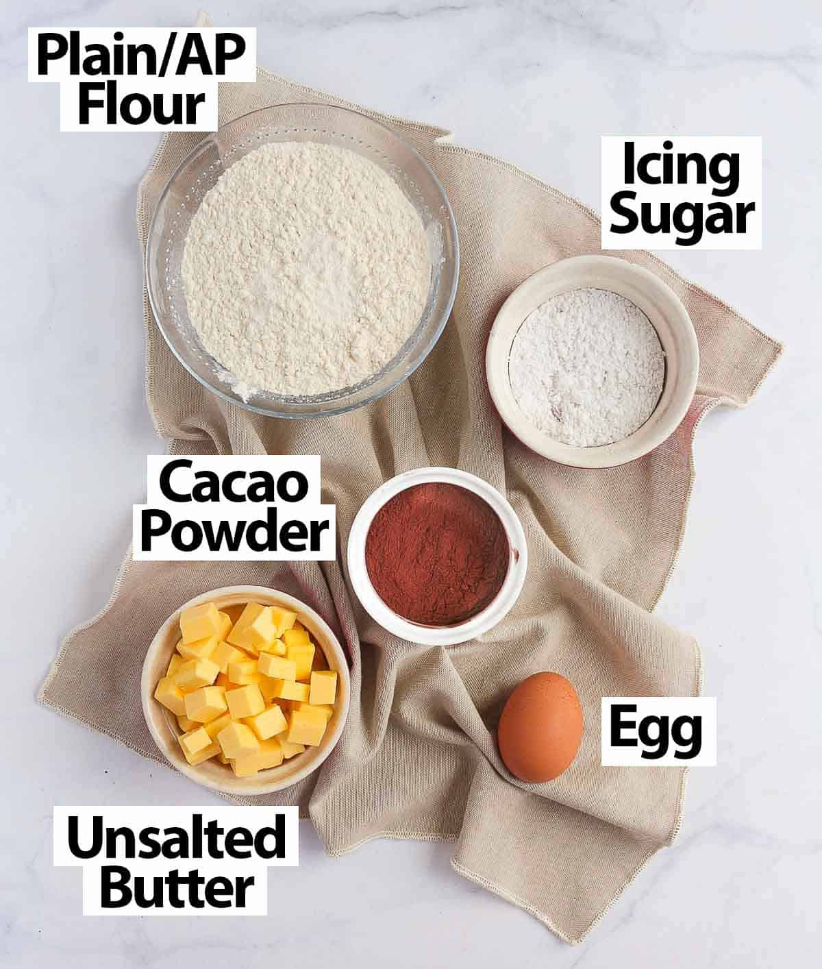 Chocolate Pastry Ingredients laid over a beige napkin.