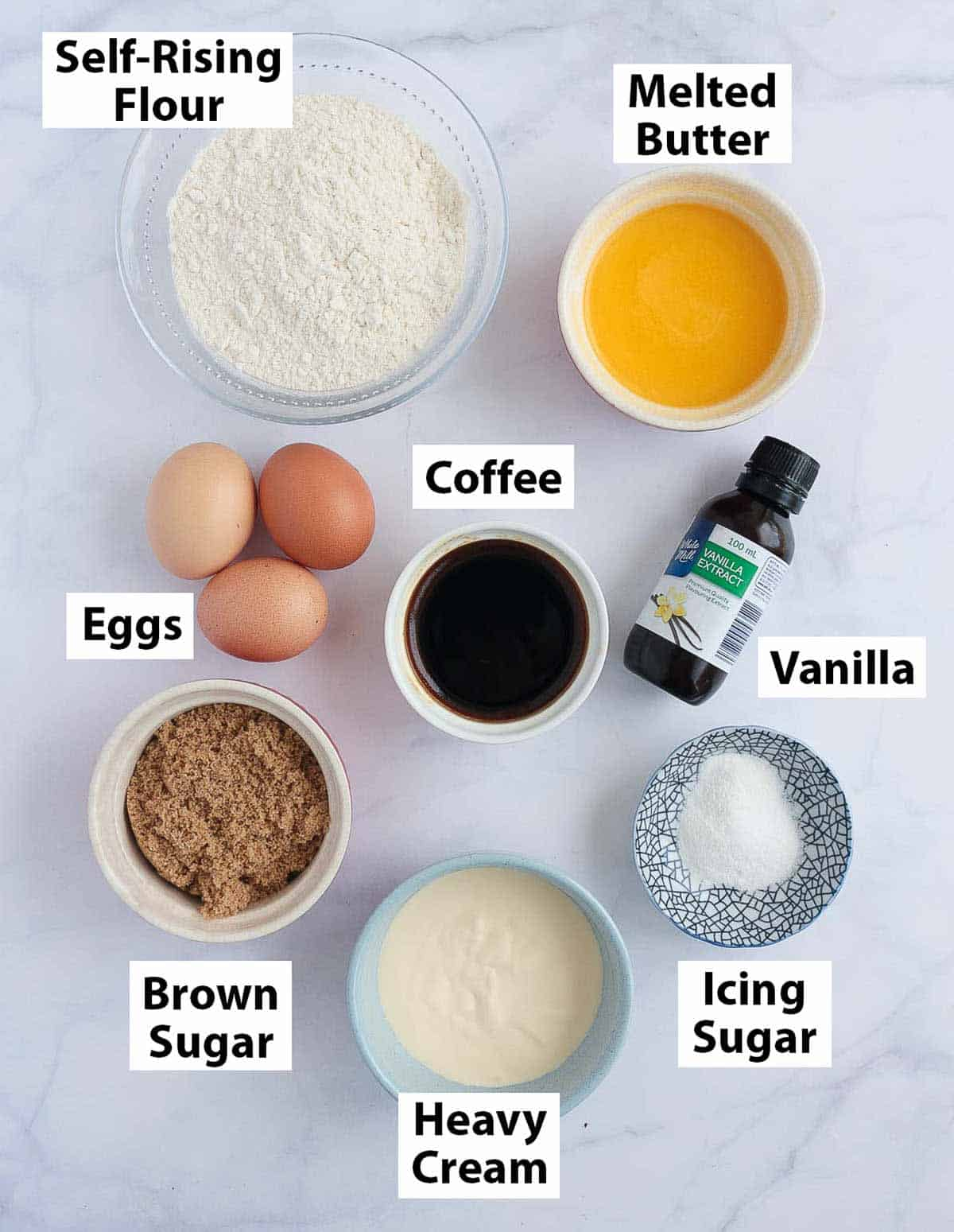 Ingredients placed on a marble surface.