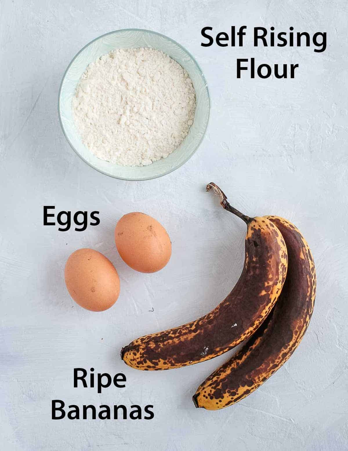 Ingredients placed on a white surface.