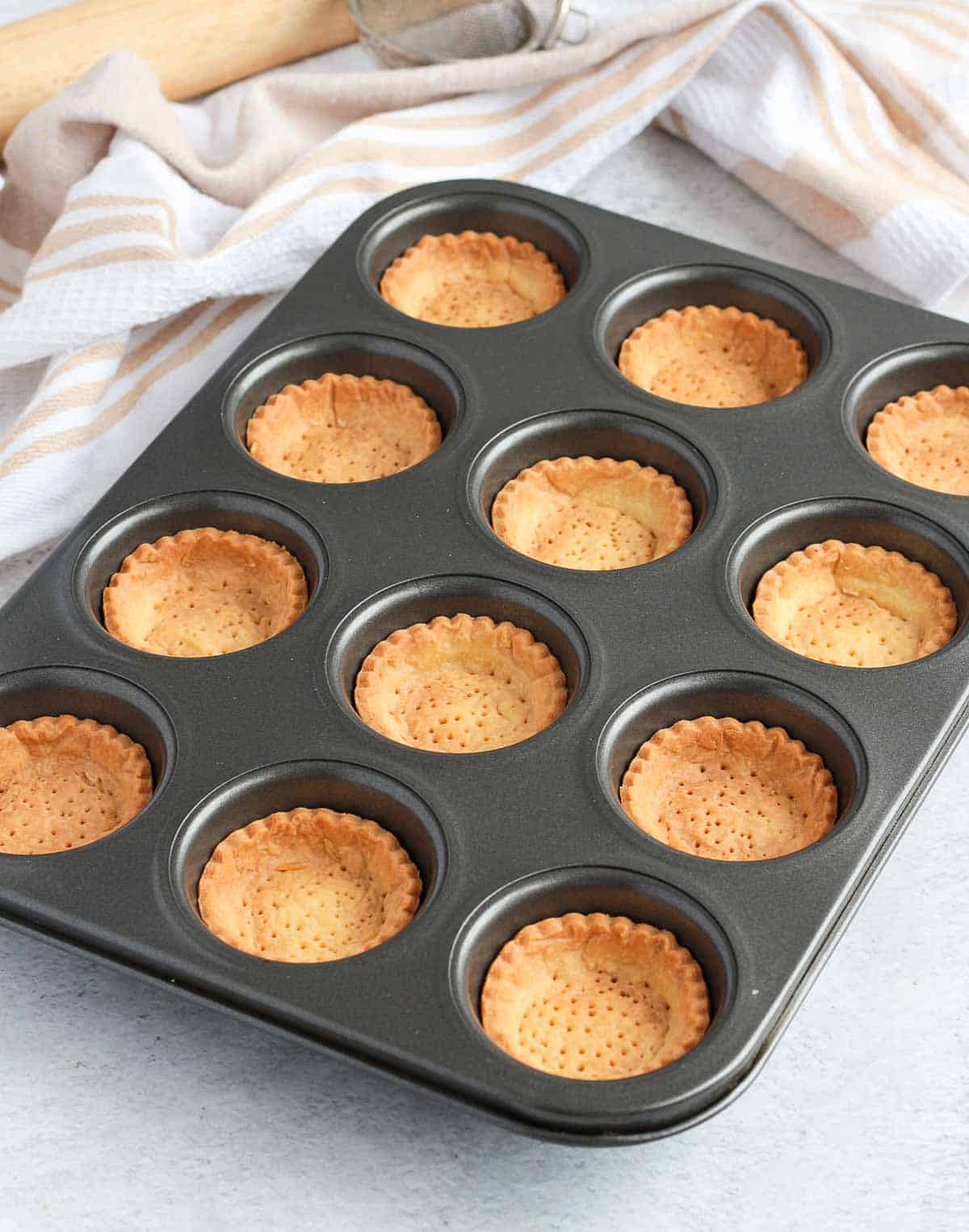 Baked tartlet crusts in the muffin pan.