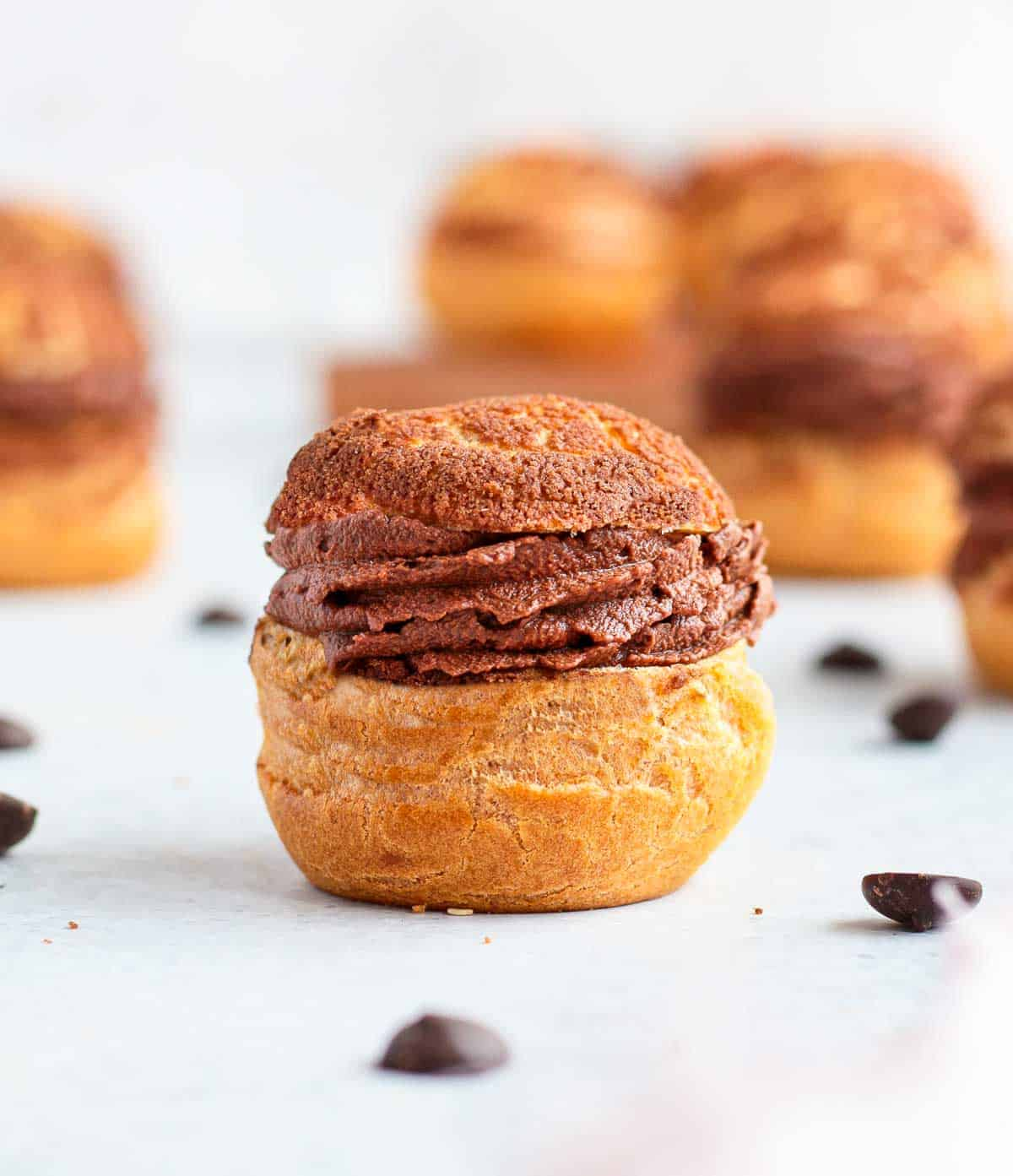 Ganache piped inside a Choux Bun.