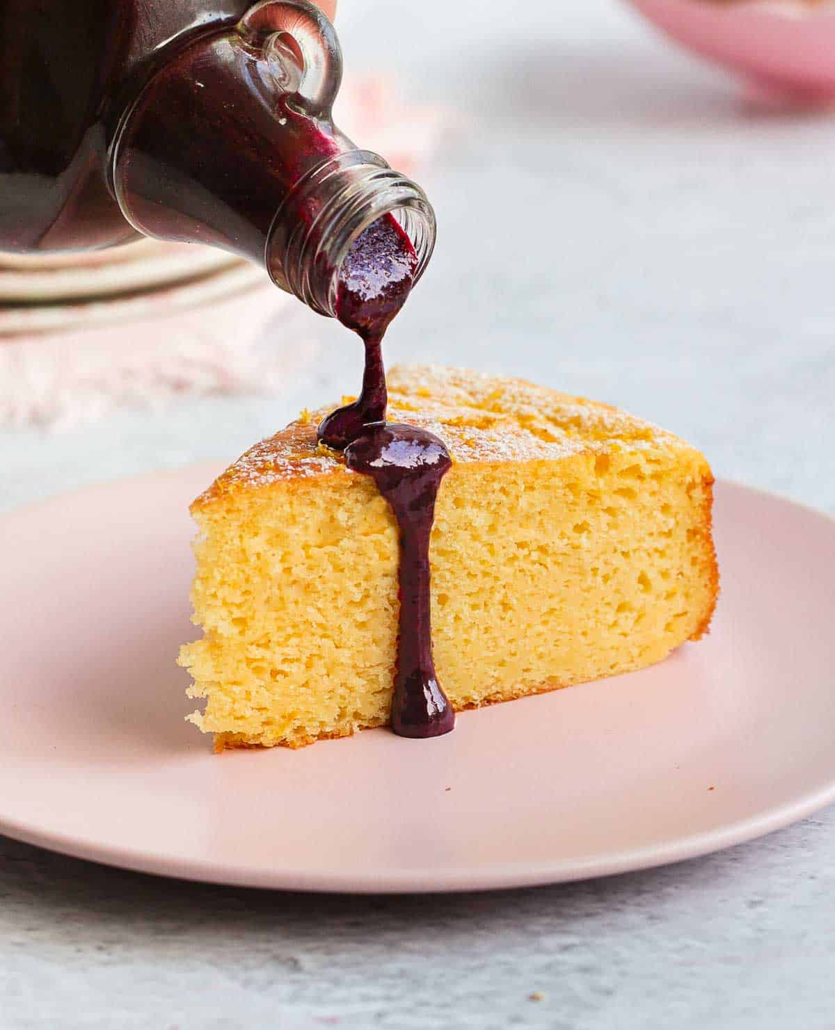Pouring the coulis over a slice of cake.
