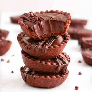 Stack of 4 chocolate tarts.