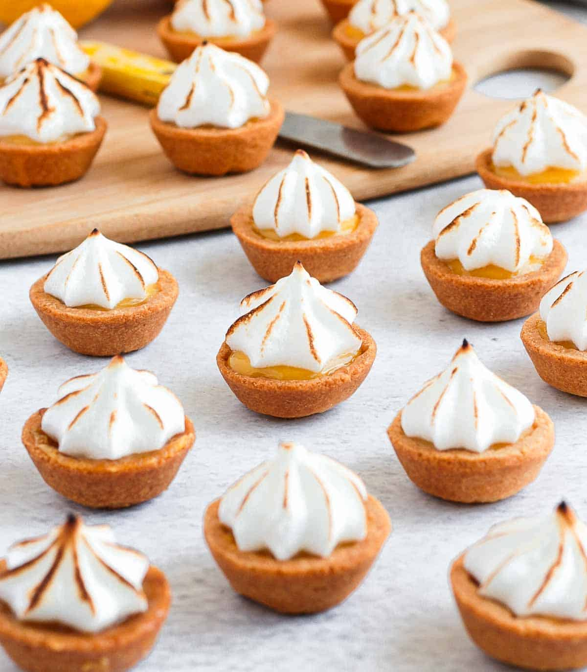 Tartlet on a grey surface with toasted meringue.