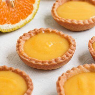 Close up on one orange tartlet.