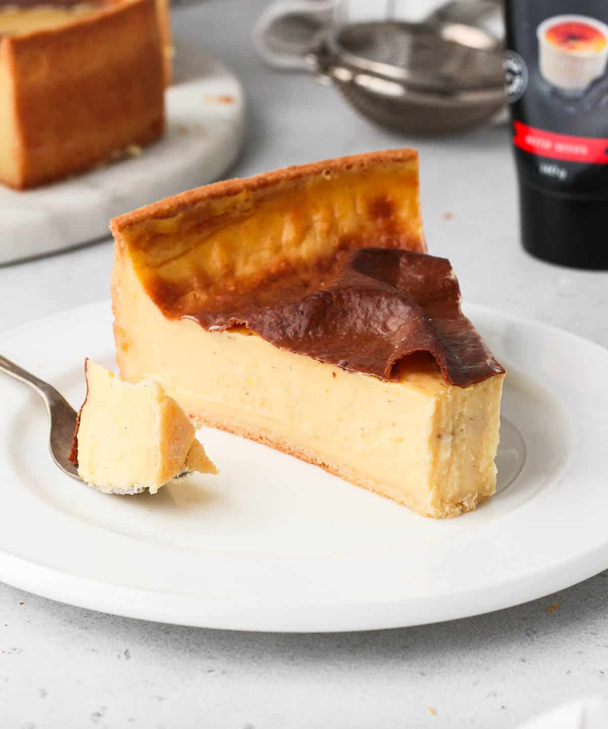 One slice of flan patissier on a white plate.