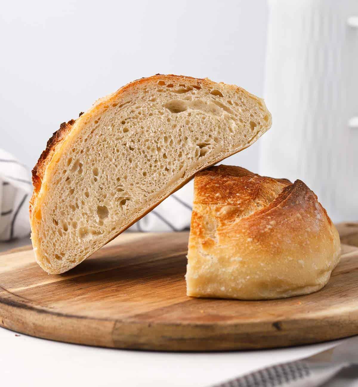 Two bread halves on a wooden board.